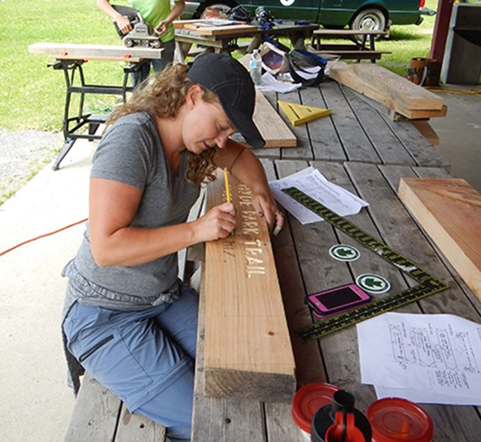 Woman making signs for trails
